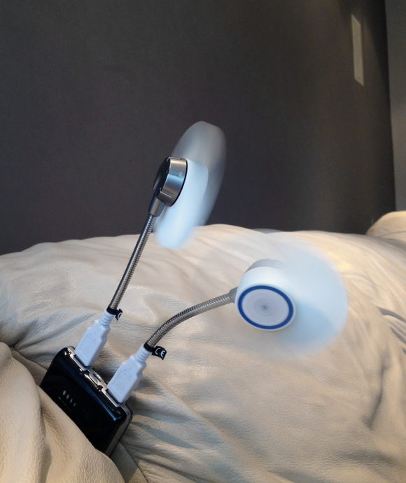 using the Arctic breeze fan with a portable charger while watching TV