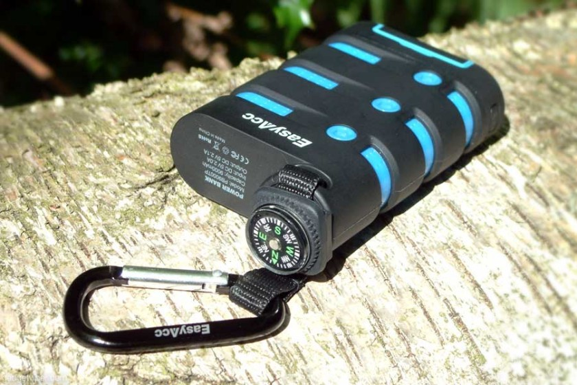 A view of the EasyAcc Waterproof power bank with the attached compass and carabiner.