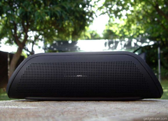 A side view of the Venstar Taco bluetooth speaker with it's perforatted finish