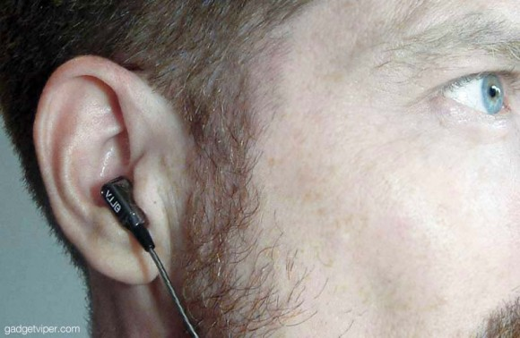 A really really ridiculously good looking ear model testing out the GranVela V1 dual driver earbuds.
