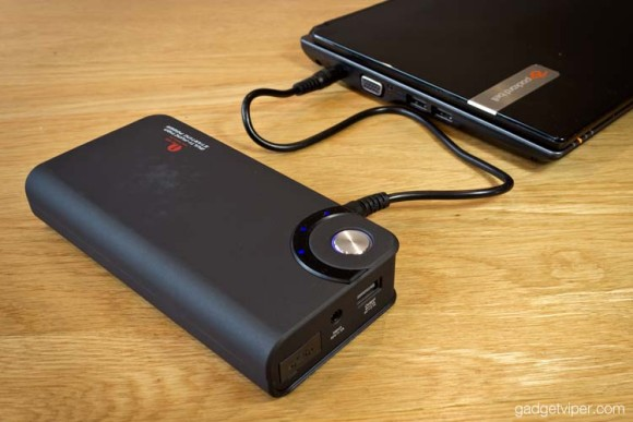 The 1byOne car jump starter charging a laptop
