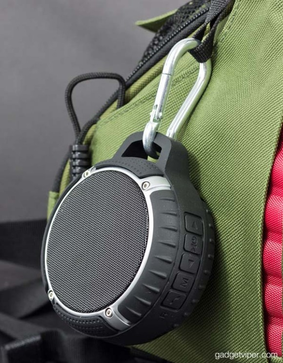 The 1byOne waterproof bluetooth speaker attached to my DSLR camera bag