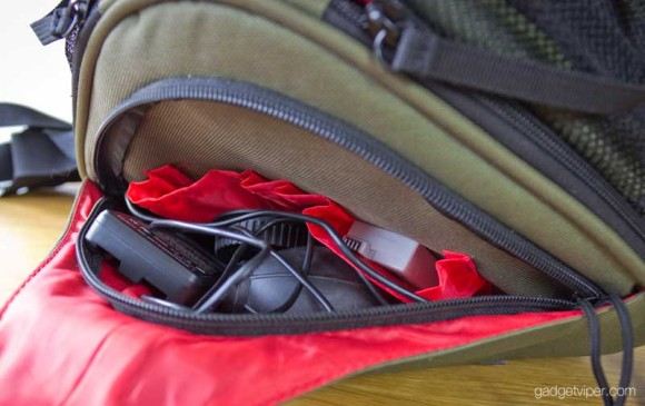 Additional space for DSLR accessories in the front pocket of the Caden K1 camera bag