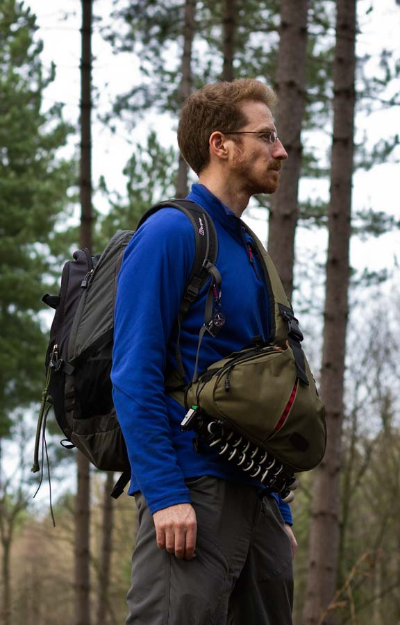 TheCaden K1 worn together with a regular hiking backpack