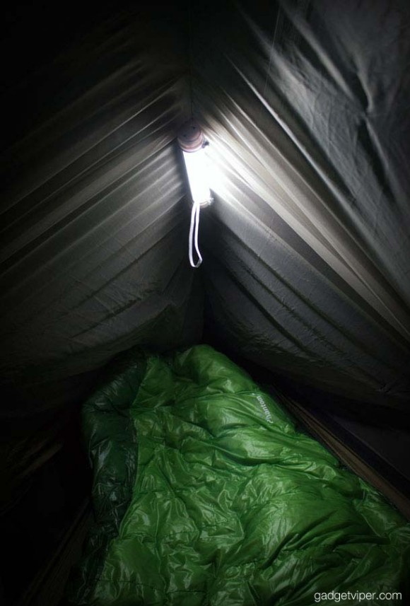The OxyLED Q6 LED lantern used on a hammock ridgeline.
