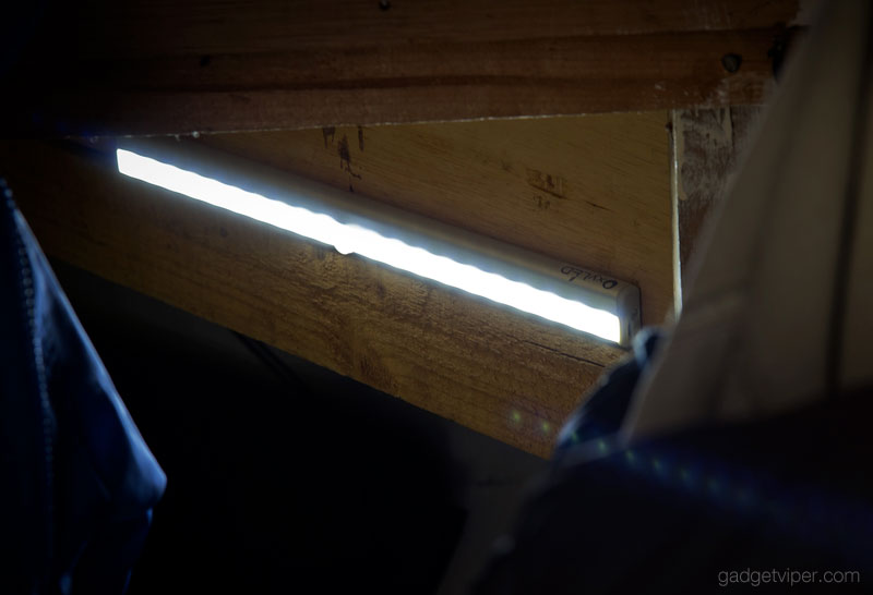 The OxyLED T02s wireless LED motion sensor light fitted in a dark under-stairs cupboard