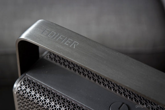 The Edifier logo stamped on the handle of the MP700 portable bluetooth speaker