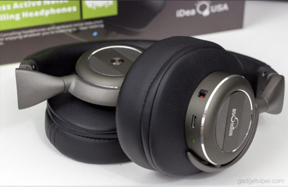 The AtomicX V203 Active noise cancelling wireless headphones folded up for storage