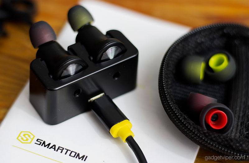 The SmartOmi Boots - Wireless Bluetooth Earbuds inside the charging dock