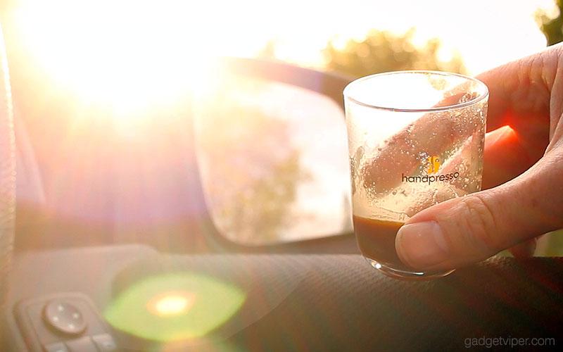 Enjoying a Handpresso Auto coffee from the car