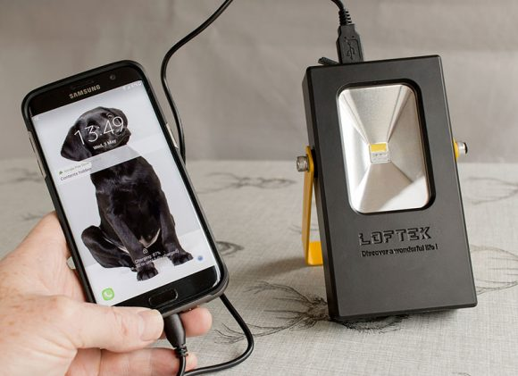 charging my phone with the Loftek portable flood light