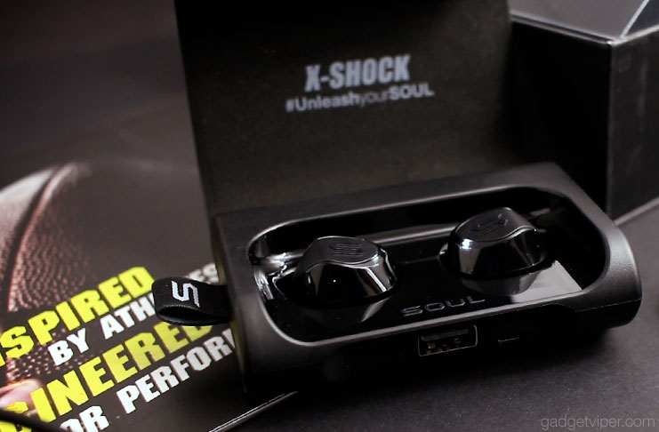 The X-Shock Bluetooth in-ear headphones in their charging station