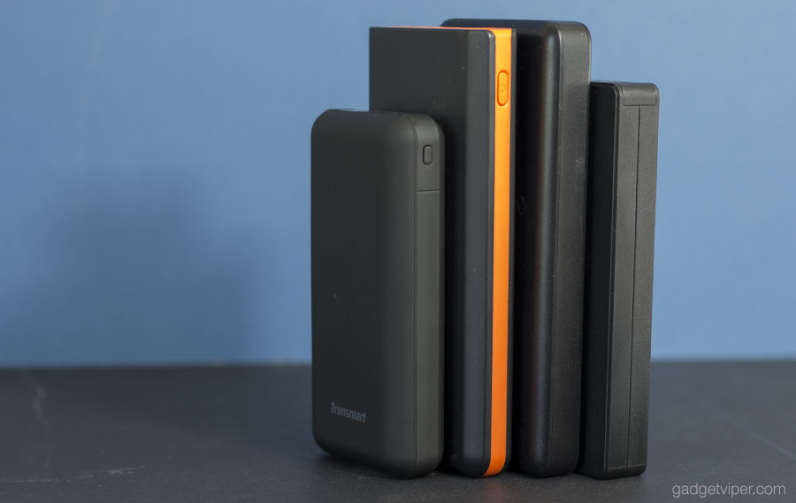 The Tronsmart PB20 Powerbank compared in size to some other portable phone chargers